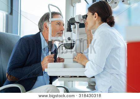 Professional Eye Doctor Sitting Opposite Her Patient