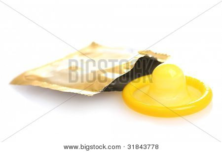 Yellow condom with open pack isolated on white