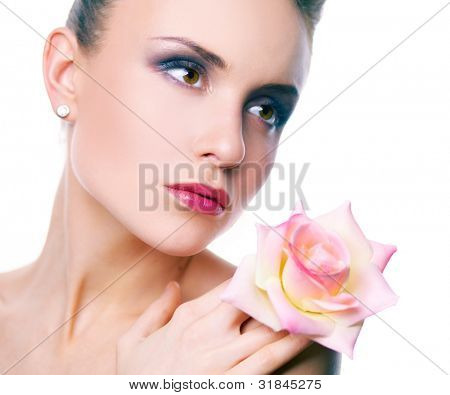 Image of gorgeous woman with pink rose by her face