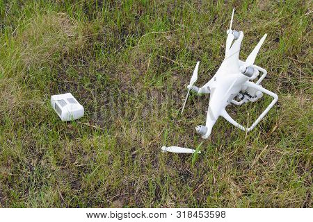 The Crashed Drone. Dirty And In The Juice Of The Grass Is A Quad