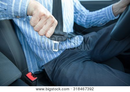 Close Up Of Man Driver Sitting On Car Seat And Fastening/wearing Seat Belt. Safety, Transportation,