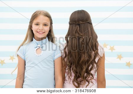 poster of Best hairstyles for long hair. Cute small girls with long brunette and blond curls in playroom. Adorable little children long loose hair. Enjoying long curly hairstyle.