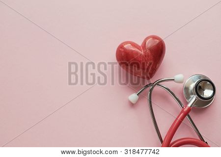 Red Heart With Stethoscope On Pink Background, Heart Health,  Health Insurance Concept, World Heart