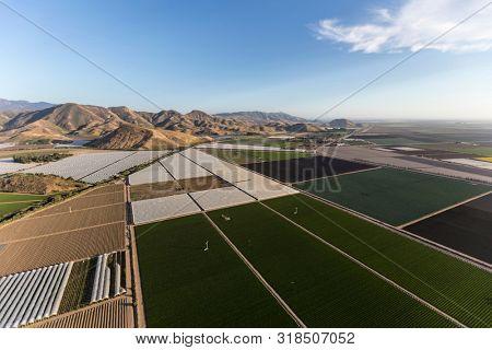 Aerial view of coastal farm fields and the Santa Monica Mountains near Camarillo in Ventura County, California.