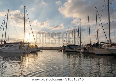 Group Of Yachts And Boats In The Marina Port At Sunset