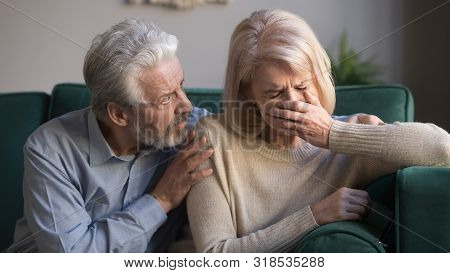 Worried Kind Senior Husband Comforting Crying Mature Wife Giving Compassion