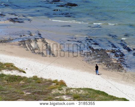 Lonely Figure On Beach