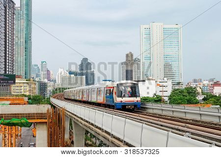 Bangkok, Thailand - August 11 2019: Bts Or Bangkok Skytrain Drive Through The Office Building Or Res