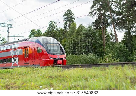 04-08-2019, Russia, Vidnoye. Red Express Train To The Airport. An Electric Train With A Carriage In
