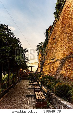 Graz, Austria - 17.08.2019 : View At Famous Castle At Schlossberg Hill And Benches. Above Graz City