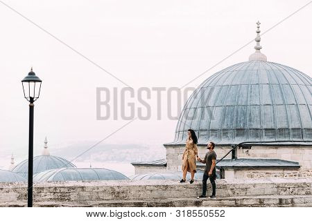 Couple Walking On The Roofs Of Istanbul. Happy Couple Traveling To Turkey. Man And Woman Walking Aro