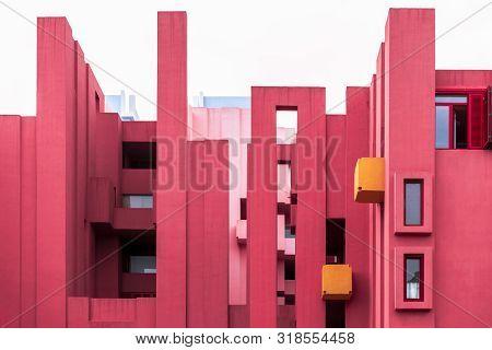 Calp, Costa Blanca, Province Of Alicante, Spain - Apr. 2019: La Muralla Roja Building By Modern Span