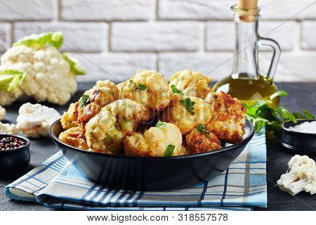 Cauliflower Florets Fried In Batter Served In A Bowl On A Concrete Table With Fresh Cauliflower And
