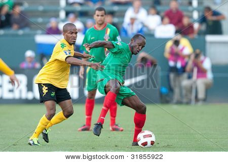 CARSON, CA. - JUNE 6: Jamaica player M Dane Richards #11 (L) & Grenada player M Ricky Charles #9 (R) in action during the 2011 CONCACAF Gold Cup group B game on June 6 2011 at the Home Depot Center in Carson, CA.