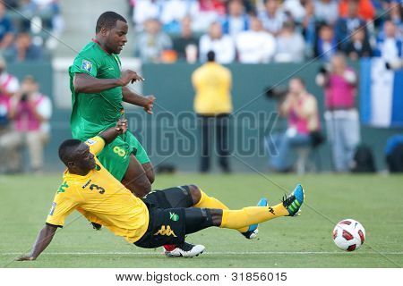 CARSON, CA. - JUNE 6: Jamaica player D Dicoy Williams #3 (F) slide tackles Grenada player F Delroy Facey #8 (B) in action during the 2011 CONCACAF Gold Cup group B game on June 6 2011 at the Home Depot Center in Carson, CA.