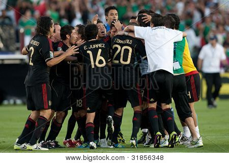 PASADENA, CA. - MAY 25: Mexico players celebrate their win over the United States at the 2011 CONCACAF Gold Cup championship game on May 25, 2011 at a sold out Rose Bowl in Pasadena, CA.