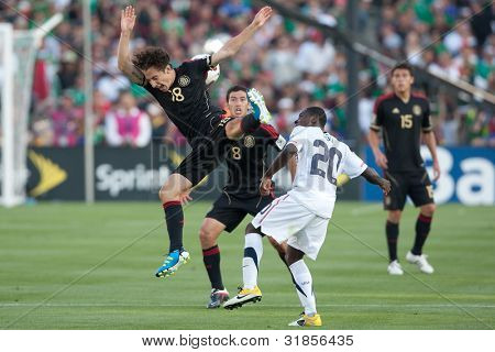 PASADENA, CA. - MAY 25: Mexico M Andres Guardado #18 (L) & United States F Freddy Adu #20 (R) during the 2011 CONCACAF Gold Cup championship game on May 25, 2011 at a sold out Rose Bowl in Carson, CA.