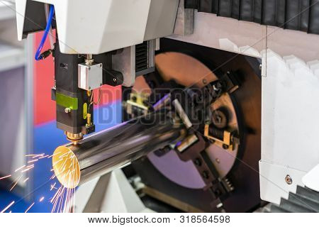 Close Up Nozzle Of High Precision Cnc Plasma Laser Cutting Machine During Engrave Or Perforate Workp