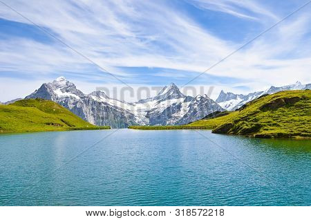 Beautiful Bachalpsee In The Swiss Alps Photographed With Famous Mountain Peaks Eiger, Jungfrau, And