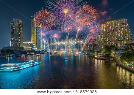 Fantastic Multicolor Firework Exploding Over The Bangkok Cityscape River Side For Celebration, Busin