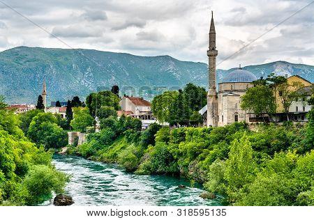 Koski Mehmed Pasha Mosque At The Neretva River In Mostar, Bosnia And Herzegovina