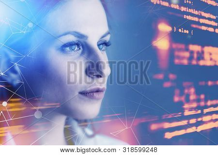 Beautiful Young Woman Programmer Looking At Virtual Screen With Code And Network Interface. Concept
