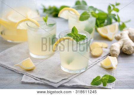 Lemonade with ginger and mint. Summer ginger lemonade with mint. Refreshing summer lemonade. Summer cold cocktail. Vitamin Healthy Drink Concept