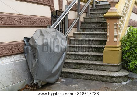 Disabled Chair Lift In A Cover Outside A Historic Building