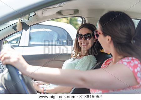 Young Female Best Friends Having Fun At Car Roadtrip Moment Transportation Concept And Urban Ordinar