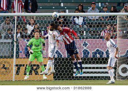 CARSON, CA. - JUNE 1: Chivas USA F Chris Cortez #27 (R) & Vancouver Whitecaps FC D Mouloud Akloul #50 (L) during the MLS game on June 1, 2011 at the Home Depot Center in Carson, CA.