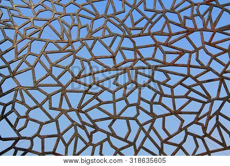 Rusty Metal Abstract Fence Background Texture Against A Blue Sky In Kusadasi, Turkey.