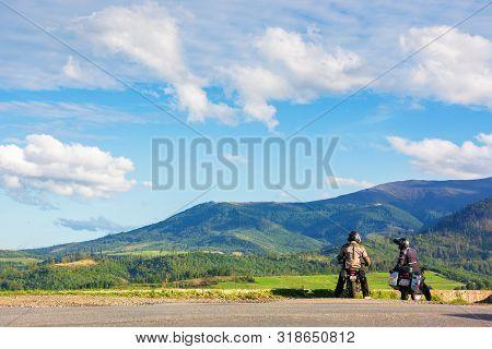 Volovets, Ukraine - Sep 15, 2017: Two Motorcyclist On The Road Enjoying Alpine Scenery. Beautiful Mo