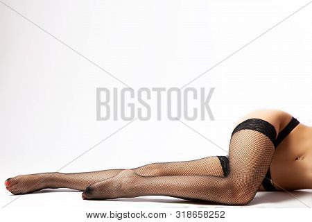 CLose up of the slim and beautiful legs in  black sexy nylon black pantyhose in black shoes. Woman in hosiery.Concept of beauty woman posing for legs. poster