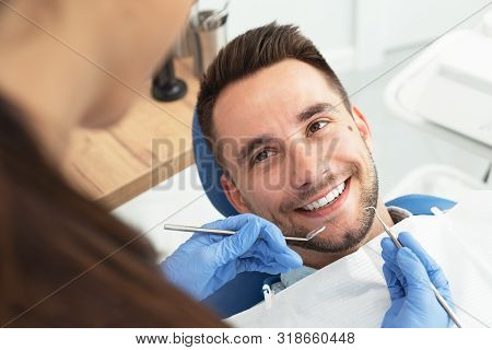 Man Having A Visit At The Dentist's