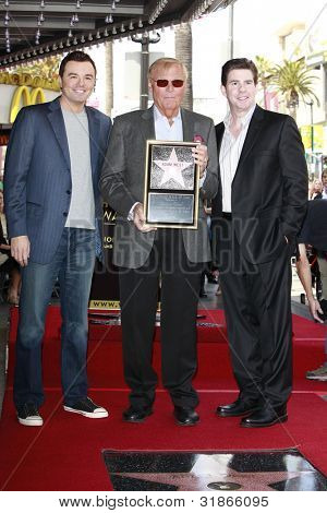 LOS ANGELES, CA - APR 5: Seth MacFarlane, Adam West, Ralph Garman at a ceremony where Adam West is honored with a star on the Hollywood Walk of Fame on April 5, 2012 in Los Angeles, California