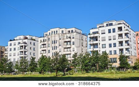 Modern Apartment Houses With A Green Park Seen In Berlin, Germany