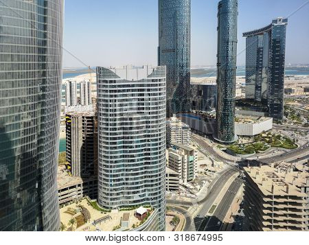 Top Aerial Drone Shot Of City Skyscrapers - Al Reem Island Sun, Sky And Gate Towers In Abu Dhabi Cit