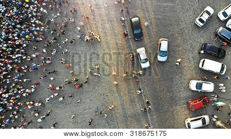 Aerial. Parking Lot With Cars And People Crowd. Crowded City Square. Top View.
