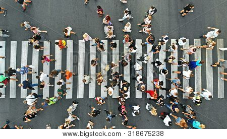 Aerial. People Crowd On Pedestrian Crosswalk. Top View Background.