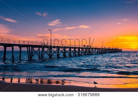 Port Noarlunga Jetty With People At Sunset, Adelaide, South Australia