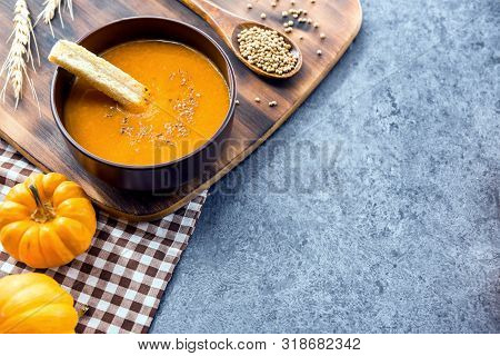 Pumpkin Soup For Halloween And Thanksgiving Party. Harvest And Fall Autumn Season. Food For Winter H