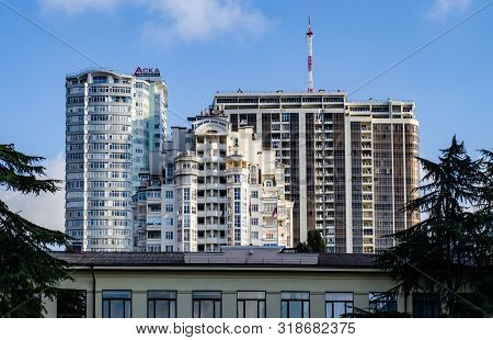 Sochi, Russia - November 24, 2018: Residential Buildings On A Background Of Blue Sky And A Tv Relay