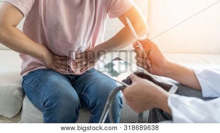 Abdominal Pain Patient Woman Having Medical Exam With Doctor On Illness From Stomach Cancer, Irritab