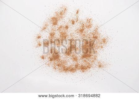 Ground Cinnamon Powder Isolated On White Backgroud.