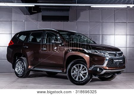Novosibirsk, Russia - July 31, 2019:  Brown Mitsubishi Pajero Sport, Close Up Of A  Front View New