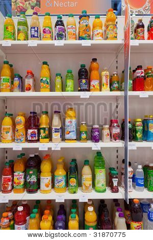 COLOGNE, GERMANY - MARCH 27 : Many different drink bottles on display at the Sidel booth at the ANUGA FoodTec industry trade show in Cologne, Germany on March 27, 2012.