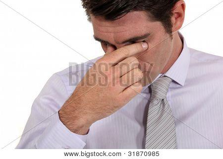 Businessman with a headache