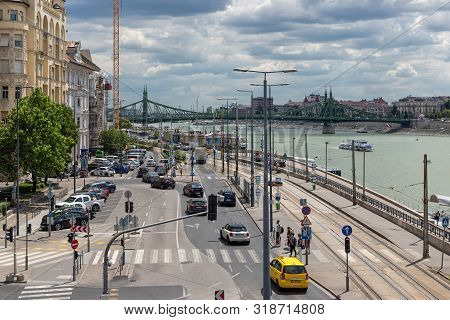 Budapest, Hungary - July 10, 2019: Waterside Danube In Budapest With Buildings And Traffic