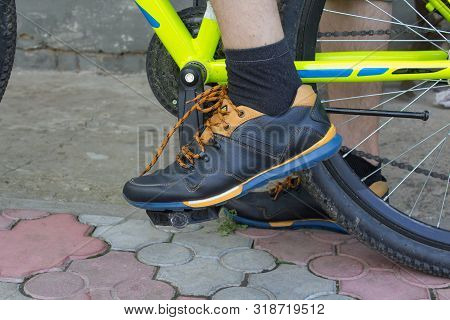Sneakers On The Bicycle Pedal, Male Foot On Bicycle Pedal Close Up Side View