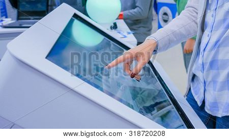 Woman Hand Using Interactive Touchscreen Display Kiosk At Futuristic Scifi Exhibition - Close Up Sho